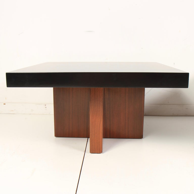 Pair of X-based walnut end tables, designed by Milo Baughman for Thayer Coggin, circa 1960s. The tops have been lacquered in a great contrasting ebony. Tables can be used as end or side tables, or pushed together as a coffee table.