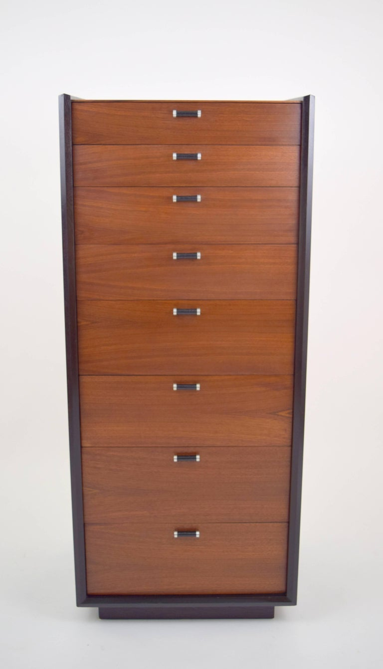Amazing Milo Baughman lingerie chest for Glenn of California. Walnut drawers and top surface, with java stained case resting on inset plinth base. Angle and beveled case offset by eight beautiful walnut grained drawers and leather wrapped aluminum