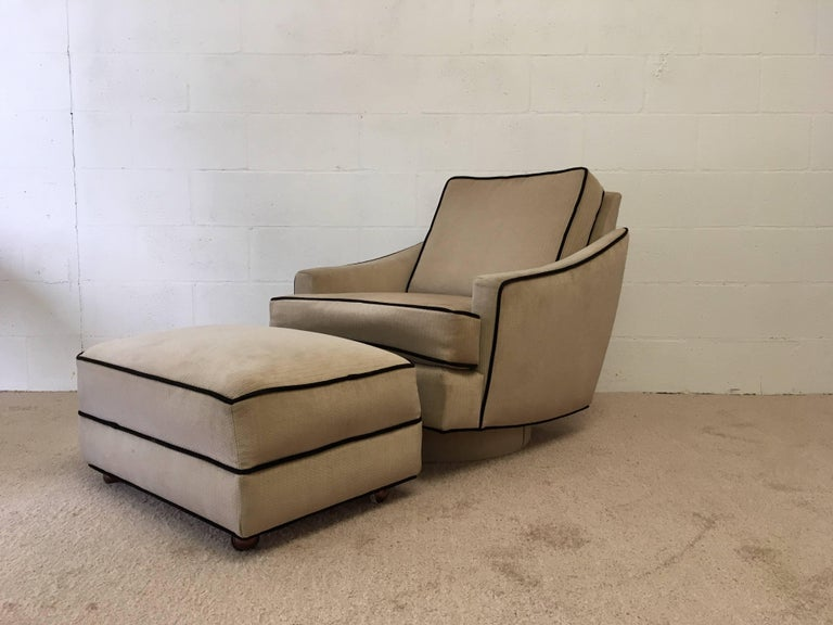 Great set! Ottoman has casters, chair swivels and rocks. Set needs to be recovered, we can help. Ottoman is 13'' tall, 27