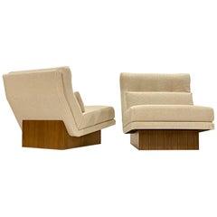 Milo Baughman Lounge Chairs on Walnut Plinths