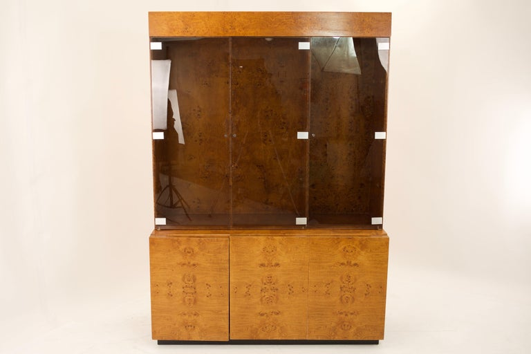 Mid Century burlwood credenza with hutch Credenza: 55.5 wide x 19.75 deep x 28.25 high; Hutch: 55.5 wide x 19.75 deep x 50.75 high Credenza and hutch together measures: 55.5 wide x 19.75 deep x 79 high This price includes getting this set in what we