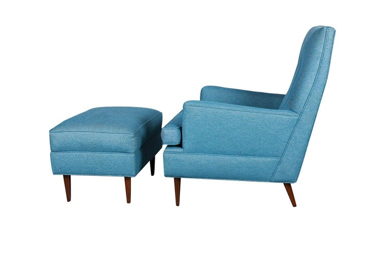 Extraordinary Mid-Century Modern high back armchair and ottoman designed by Milo Baughman, circa 1970s. This gorgeous chair and ottoman feature original blue upholstery, removable seat cushion that is well intact, high supportive arms and tight
