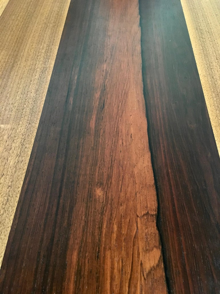 Mix of rosewood, walnut and ash makes this table top stand out supported by four ebonized legs and two 20