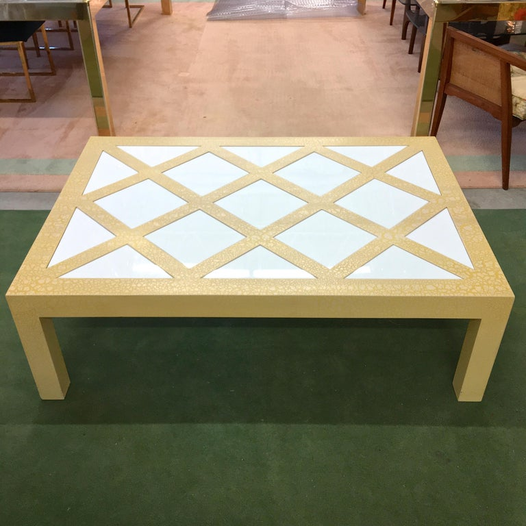 Milo Baughman for Thayer Coggin, circa 1972 rectangular parsons cocktail table in yellow crackled finish with inset white Vitrolite glass parquetry tiles, square and triangle, forming a checkered trellis pattern.