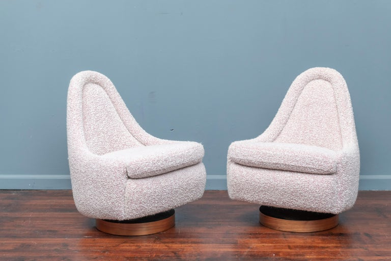 Milo Baughman petite swivel and tilt lounge chairs for Thayer Coggin. Recently upholstered in boucle with rosewood veneer bases.
