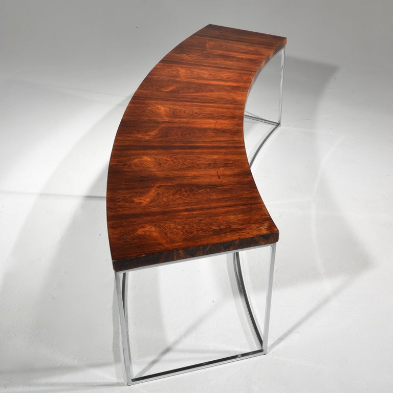This is a rare Milo Baughman rosewood and chrome bench or table for Directional.
