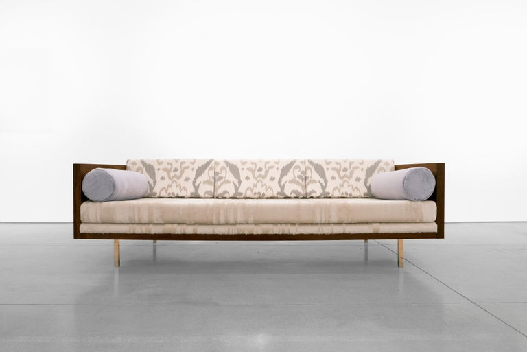 """Wrapped rosewood three-seat sofa. Meticulously reupholstered with Dedar Milano fabrics, designed by Milo Baughman in the 1950s.  Milo Baughman brought comfort and ease to the simplicity and functionality of modern furniture. """"Furniture that is too"""