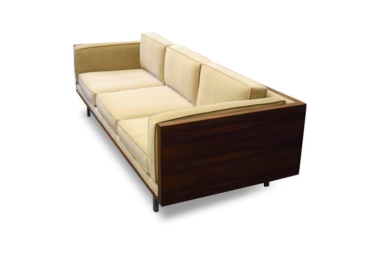 Milo Baughman rosewood case sofa.