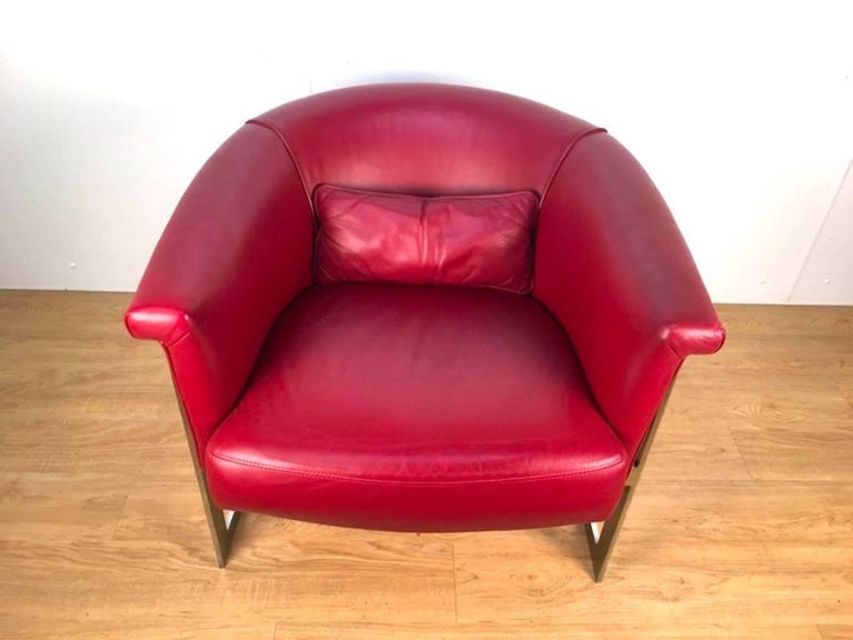 John Stuart stylerounded lounge chair in custom red leather. Clean, bright frame with rich red leather upholstery and accent pillow.
