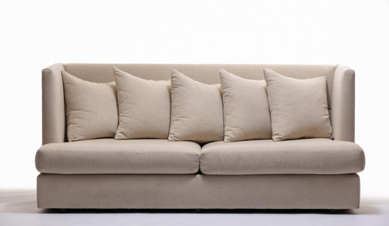 Milo Baughman shelter sofas designed in 1970. Pair available and priced individually. Designer sofas that check lots of boxes: stylish to gaze upon, yet perfect for lounging, napping, or watching TV. The seats are deeper than a twin bed. Tall backs