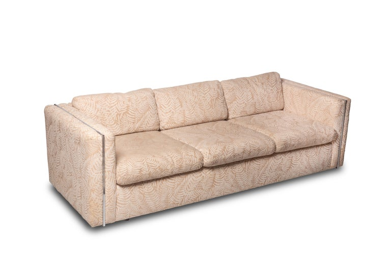 The couch is the Milo Baughman Classic design for Thayer Coggin and retains what seems to be its original upholstery (which is in surprisingly good condition). The couch could easily be placed in a living room as/is with the vintage upholstery…which