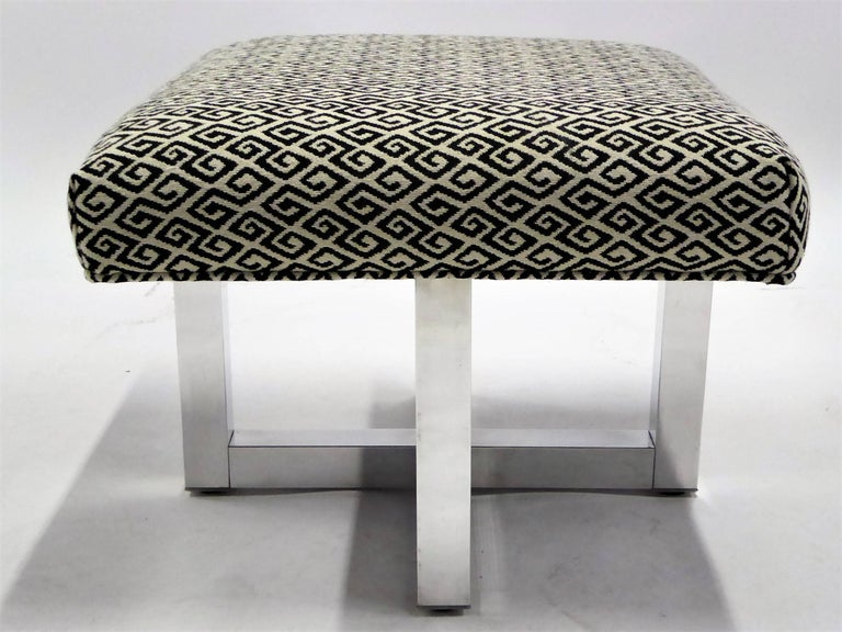 Offered in pairs, from the 1960s, stools or benches in the style of Milo Baughman. With polished X-aluminum bases with superb upholstered seats in vintage woven wool Meander / Greek Key motif fabric with welting. Sold in twos, two pairs