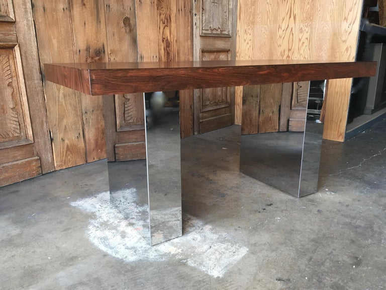 Rosewood with chrome trestle base library table that can be used as a dining table or foyer table or desk.