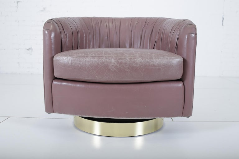 Swivel chair by Milo Baughman. Reupholstered in pleated leather in the 1980s. Least her is vintage and shows wear.