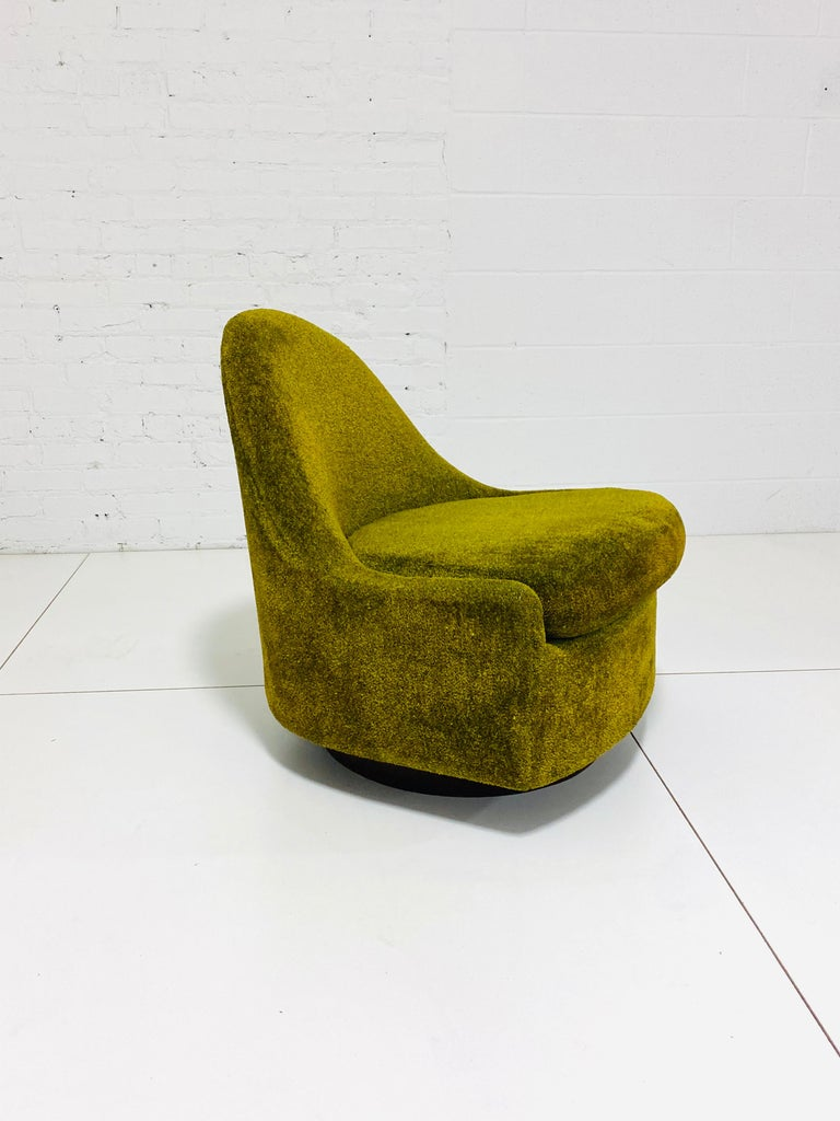 Teardrop shape lounge chair by Milo Baughman. Unique petite form perfectly Contours body. Chair swivels and rocks.