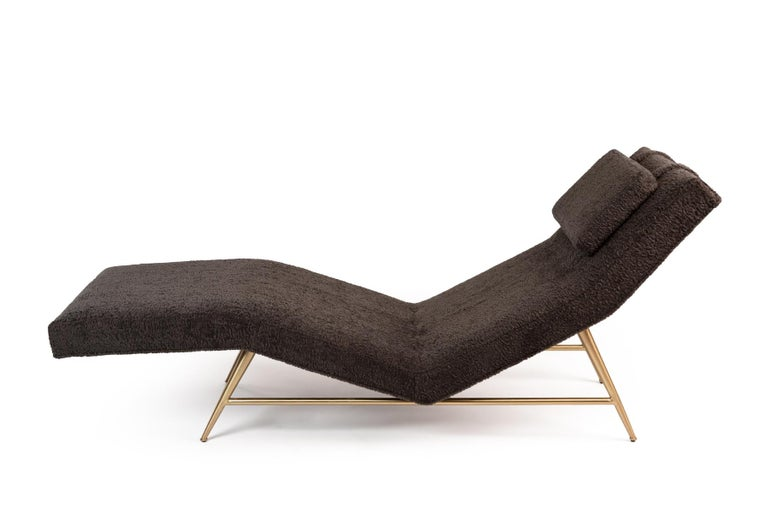 A savvy chaise longue chair by Milo Baughman for Thayer Coggin expertly reupolstered in one long, sinuous panel of plush charcoal faux sheepskin. Legs are satin finished brass.