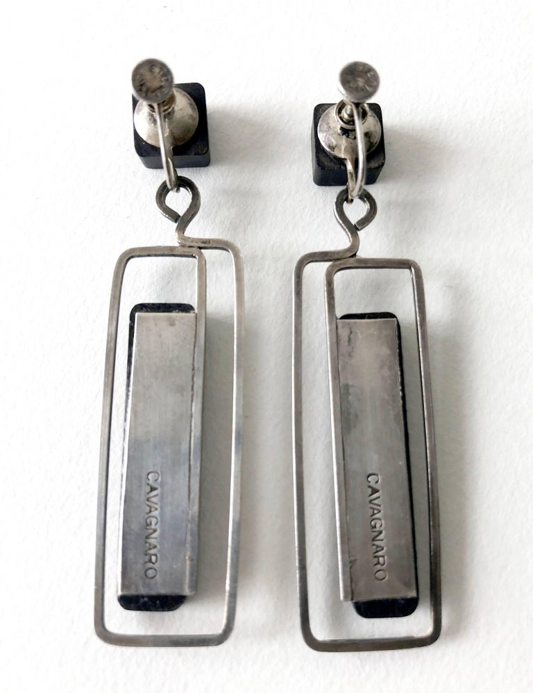 Handmade modernist studio ebony and sterling silver earrings by Milton Cavagnaro of Mill Valley, California.  Earrings are of the screwback variety and measure 2 3/8