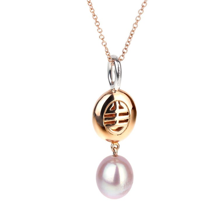 A fabulous drop necklace by Mimi Milano featuring a 3.90 ct peridot followed by a 7.5x8mm violet cultured pearl adorned by round brilliant cut diamonds in 18k white and rose gold.