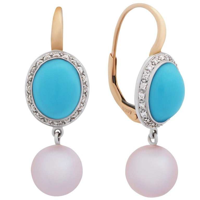 A fabulous pair of Mimi Milano earrings featuring 5.10cts of turquoise, complemented by 8mm freshwater pearls in 18k white gold and rose gold.
