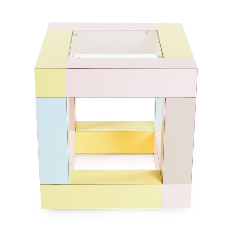 Mimosa end table in plastic laminate with glass top, designed in 1984, by Ettore Sottsass.  Ettore Sottsass was born in Innsbruck in 1917. In 1939 he graduated in architecture at the Politecnico di Torino One of the most influential and important