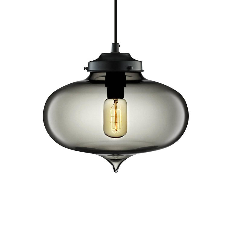 Born from the intricacies of Moorish architecture, the seductive Minaret features a hand-pulled tear-drop shape that reflects refined beauty. Every single glass pendant light that comes from Niche is handblown by real human beings in a