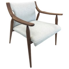 Mince Armchair in Walnut Featuring Curved Arms and Spindle Legs