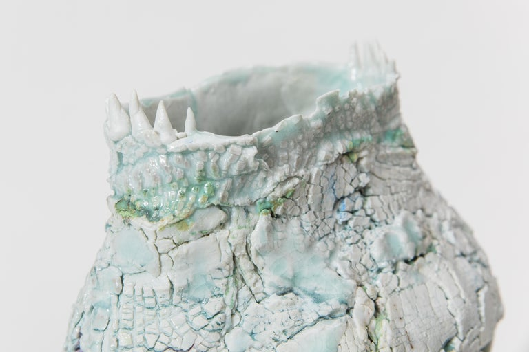 Mindy Horn's non-functional vessels, purposely thrown off center, appear to have grown and weathered organically. The surfaces of the vessels, crusty or cracked, emphasize their crooked, uneven forms. While their appearance seems to contradict