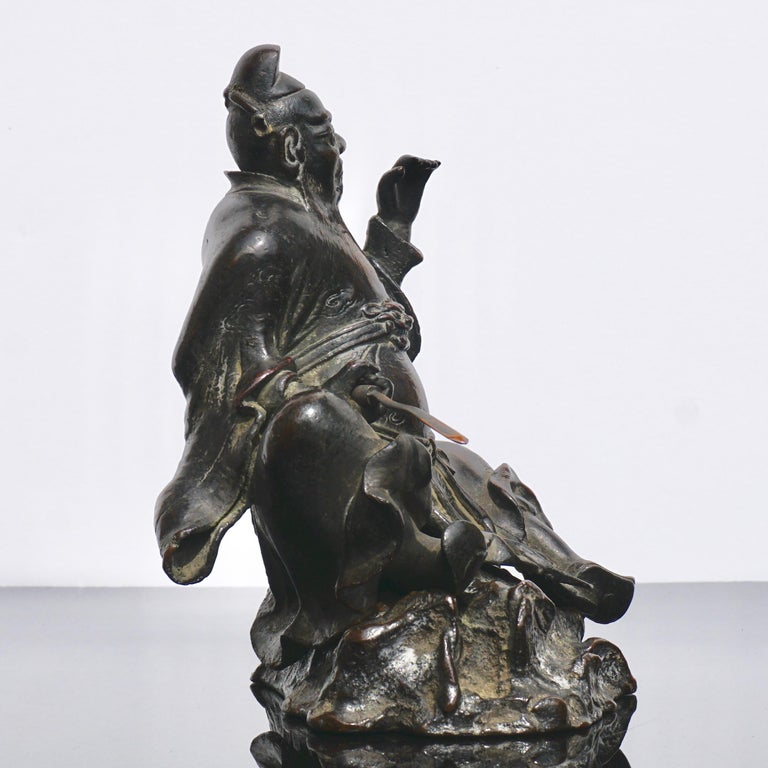 Cast Ming Dynasty Bronze Figure of Guandi or Guan Yu For Sale