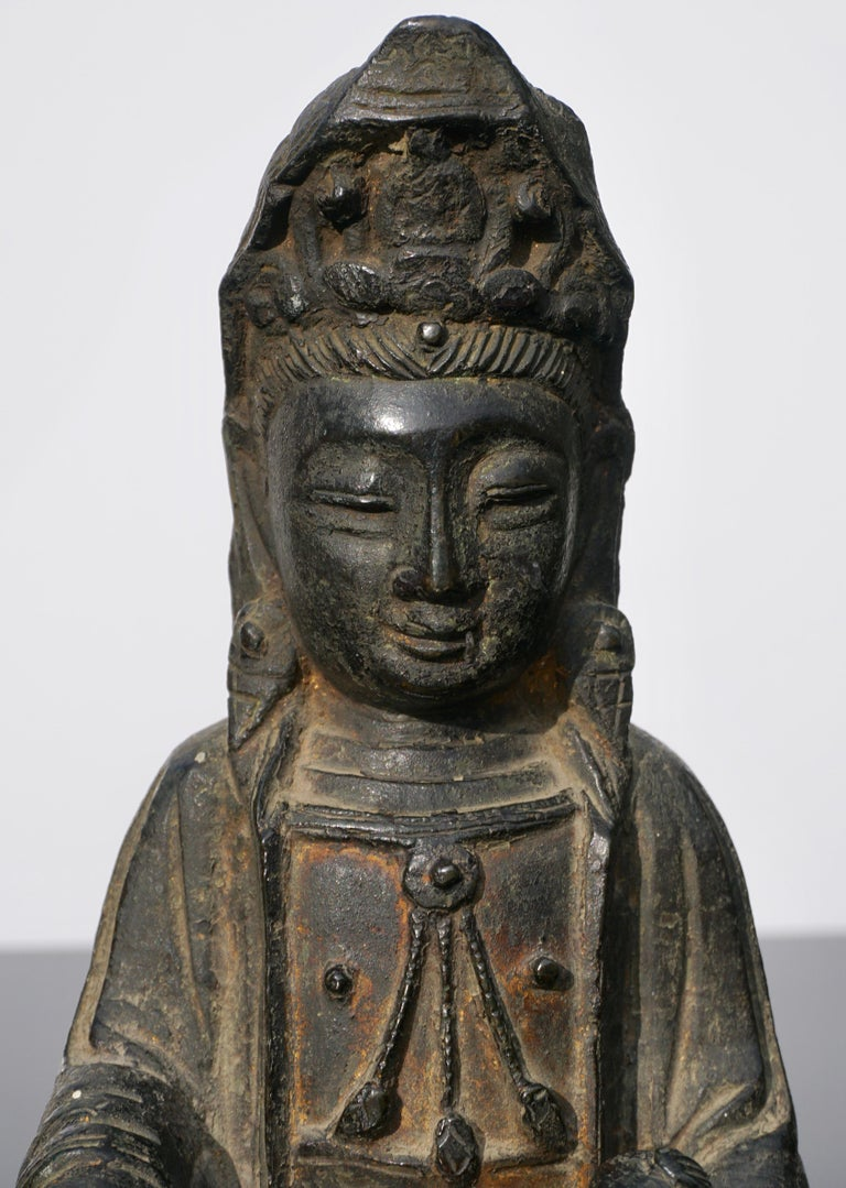 A early Ming dynasty lacquered bronze statue of the feminine Buddha figure; Guanyin with child, circa 15th-16th century China.