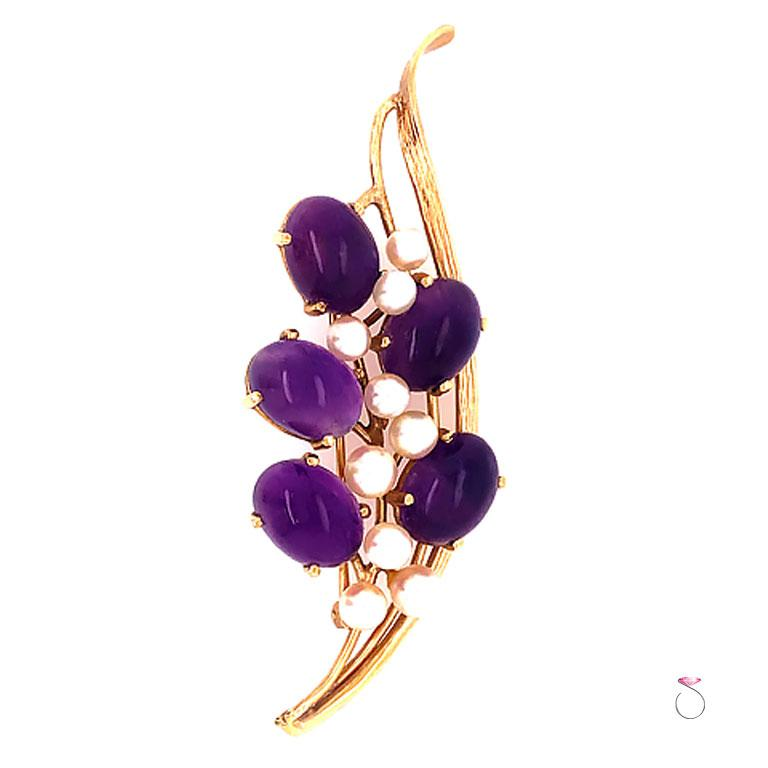 Beautiful Ming's Purple Amethyst & white Akoya Pearl flower brooch. The brooch features a floral design of five oval cabochon shape purple Amethyst and 9 small round white Akoya pearls. Each Amethyst piece is set securely in four prongs and
