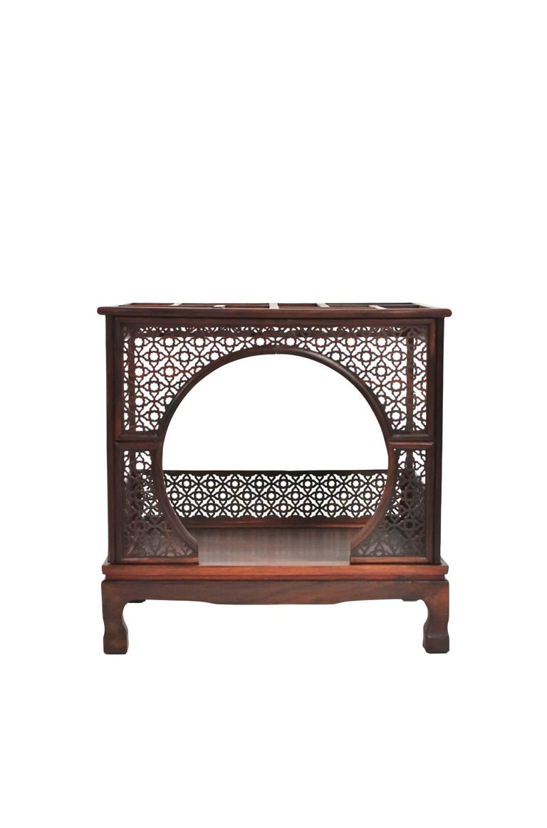 Beautiful miniature, finely carved model is the exact replica of a Chinese traditional moon bed. The bed is decorated on all sides by carved panels in an intricate pierced pattern. The moon entrance is dramatic and very romantic. The top of the bed