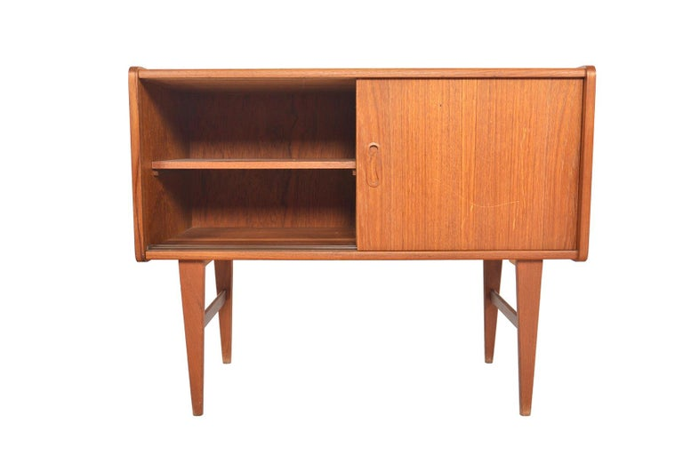 Origin: Denmark Designer: Unknown Manufacturer: Unknown Era: 1960s Dimensions: 31.5 wide x 14.5 deep x 25.5 tall Interior cabinets (each): 15 wide x 12 deep x 12 tall  Restoration Includes: • Structural + joint repair (if necessary) on all