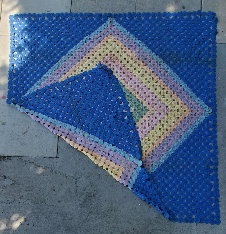 This mini pieced diamond in a square yoyo quilt. The condition is very good and it is a large quilt.