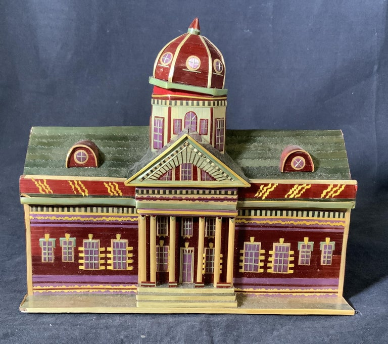 Petite house shaped stacking box made of multicolored painted wood, measures: 7 inches tall x 7 7/8 inches, top piece, the capital, is removable for storage, then opens up to a rectangular open area for additional storage. Will make a wonderful