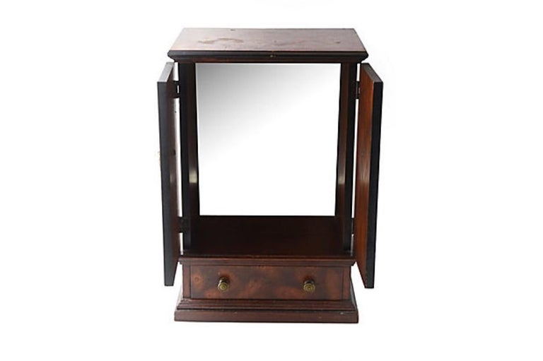 Miniature burl wood armoire cabinet. Possibly a salesman sample from the early 20th century. Can be used as a jewelry box. Features two doors on top which open to a storage area with a mirrored back. The bottom drawer is lined in green velvet and