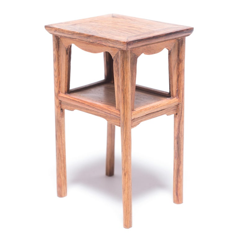 A full size table with this level of workmanship would be an incredible find, but this beautiful piece of furniture—at only four inches tall—is perfectly constructed down to the tiniest minutia. The table was crafted in northern China from a