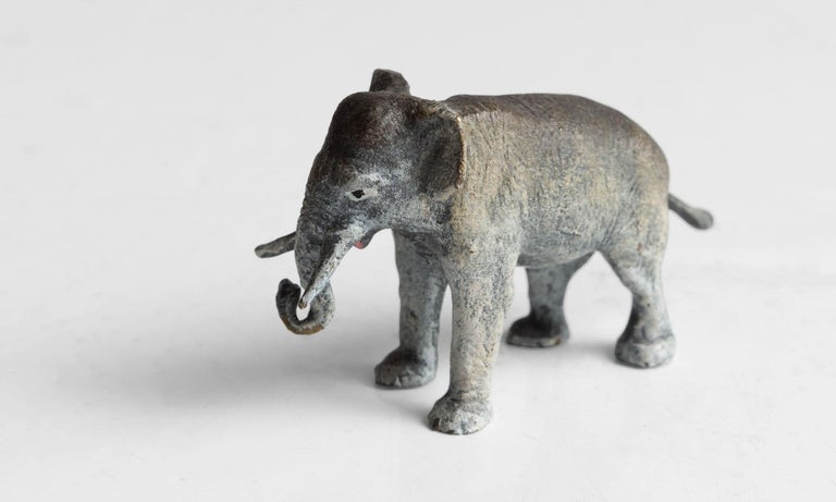 Unique cold painted elephant with beautiful patina and original paint.