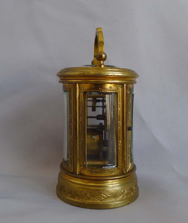 Late 19th Century Miniature French Oval, Engraved Carriage Clock For Sale