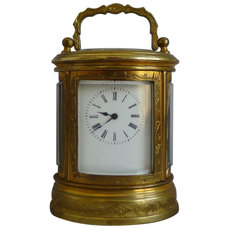 Miniature French Oval, Engraved Carriage Clock For Sale