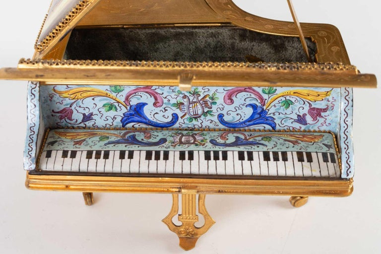 Miniature piano, music box in gilded brass and decoration of gallant scenes in enamel, 19th century, Napoleone III period.