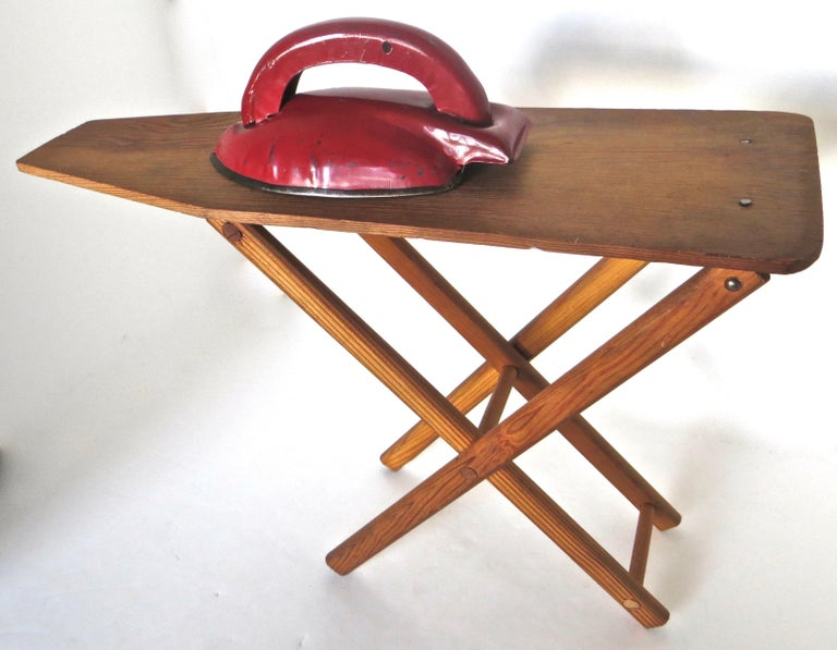 Salesman sample circa 1920 miniature ironing board accompanied by a hand painted metal iron, are both handmade and in excellent all original condition with no repairs; the iron is in it's copious original bright red paint with no touch up.