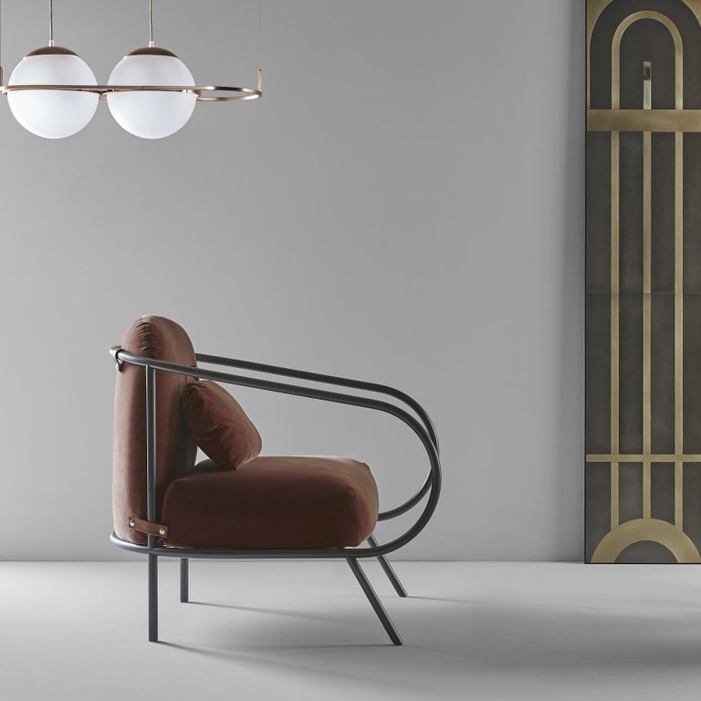 Presented for the first time at Fuorisalone during 2018 Milan Design Week, Minima is the first upholstered armchair in Mingardo's collections. Two soft cushions are hinges to the open, voluptuous frame handcrafted of black-finished iron tubes by