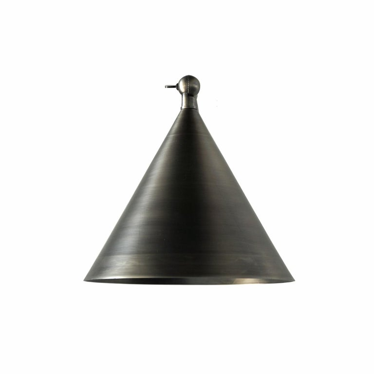 Evolving task lighting into beauty. This Classic design, finished in a stunning pewter. Transforming interior task lighting into beauty complimented in a stunning pewter finish.  All lights are handmade and made to order. Dimensions may vary