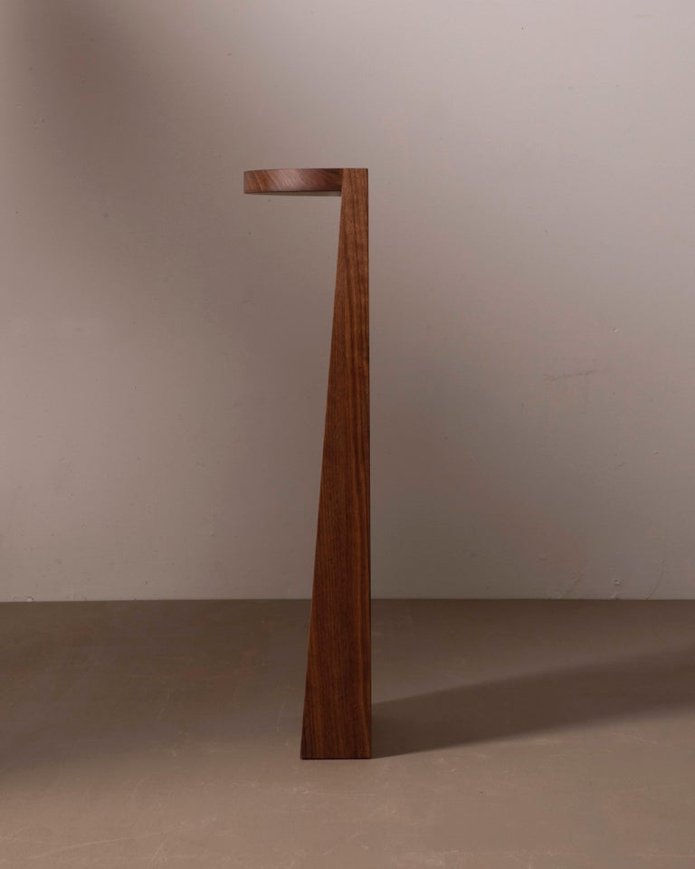 A simple wooden half circle and elongated wedge. The perfect pedestal for precious artifacts. Works as a nightstand, end table or plant stand.   Counterweighted with hidden steel in the base that provides balance on smooth surfaces.   This