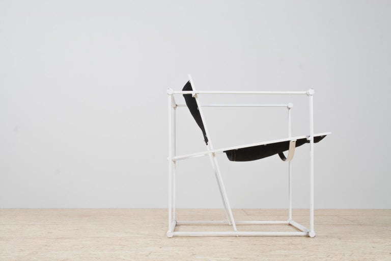 Iconic Bauhaus style and Minimalist armchair in black and white by Radboud Van Beekum for Pastoe, armchair model FM61, in steel and canvas, The Netherlands, 1981.  This Minimalist design was first presented at the 1980 Triennial in Poznan. After