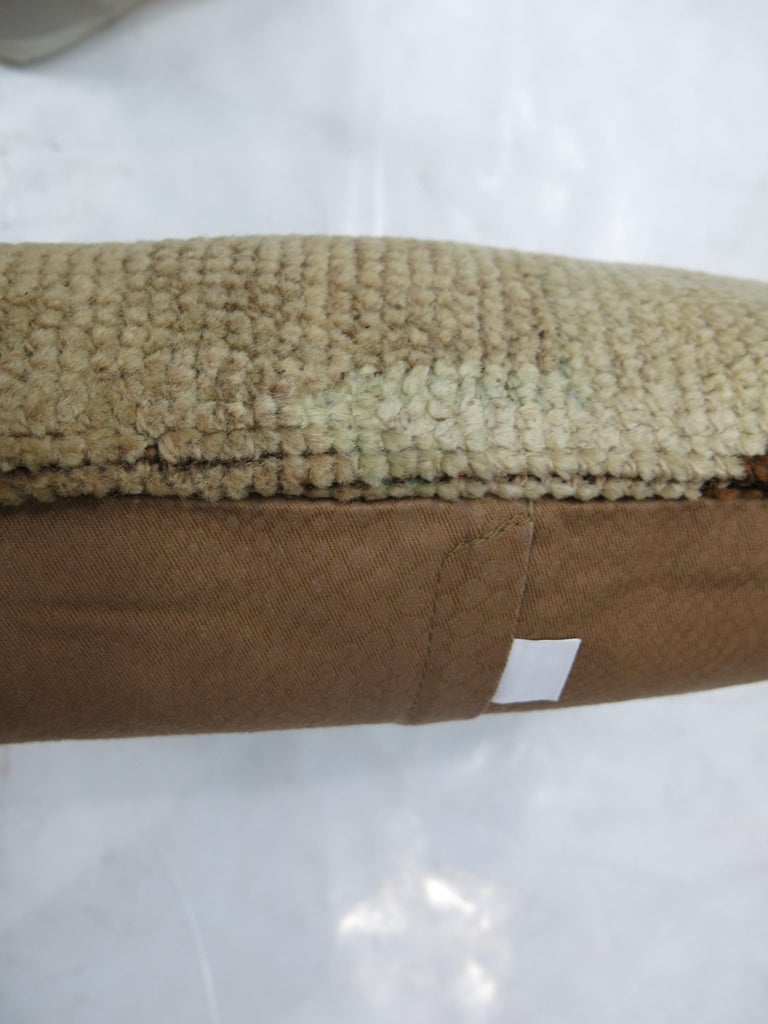 Pillow made from a vintage Turkish Oushak rug in beige and brown 