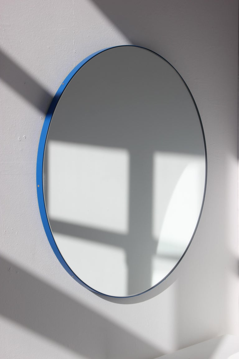 Delightful handcrafted silver round mirror with a funky blue frame.  Ideal above a console table in the hallway, above a beautiful fireplace, in the bedroom or in the bathroom.  Design tip: looks stunning used as a cluster in different sizes