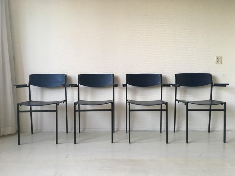 This set of four Dutch design stackable armchairs were designed by Gijs Van Der Sluis. They feature a black lacquered metal base and dark Blue seatings and backs from plywood. Multifunctional pieces (School, Office or Dining Room chairs) which