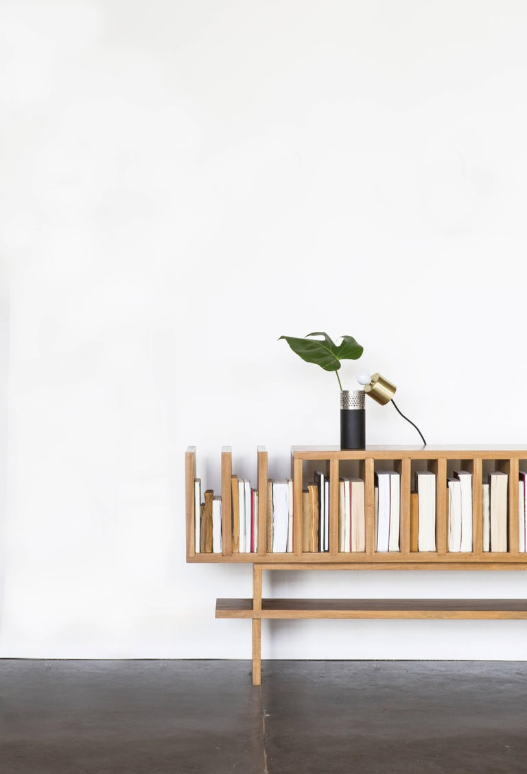 Minimalist buffet, can be a book shelf, or console table. Handcrafted in Brazilian Hardwood Freijó Available in natural wood or painted black finish. Dimensions: Depth x width x height 10.62 x 78.74 x 28.34.