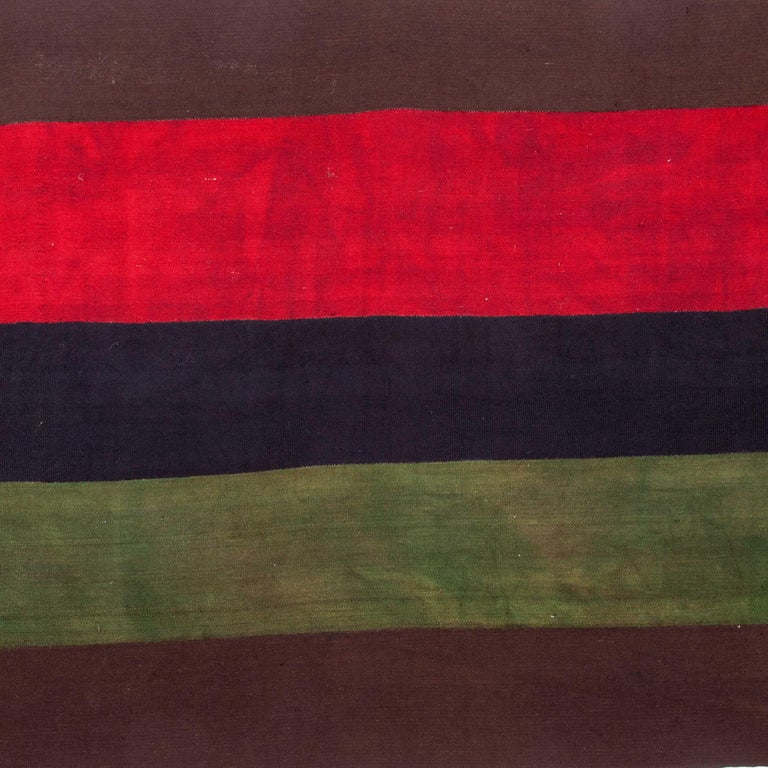 This is a fine weaving in wool that can either be used on the floor or on a wall or a caoch. Deep well saturated colors.